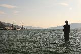 Mo_i_Rana_022_07092019 - Silhouette of the Sea Man looking towards some industrial dock in the distance