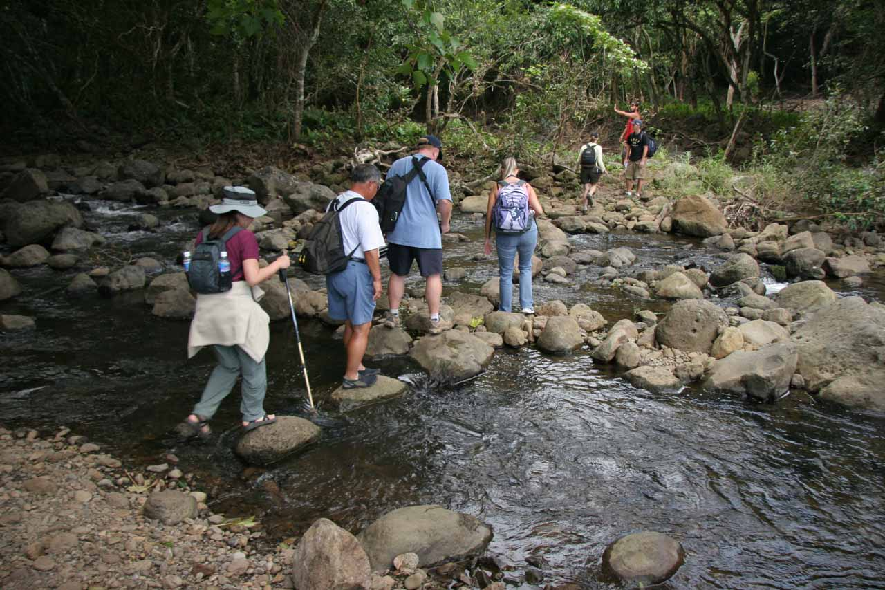 The group crossing the stream