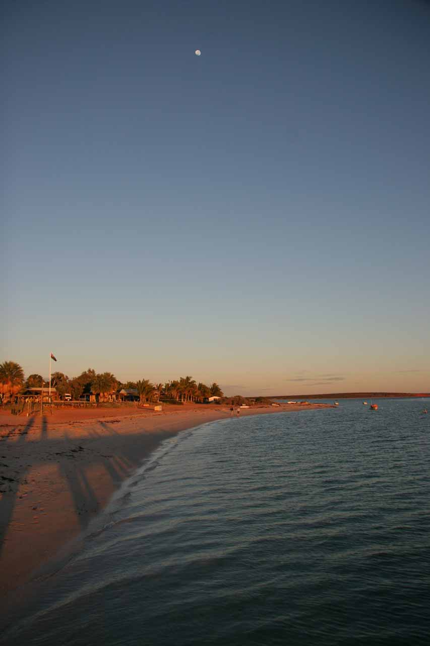 Moon over the Monkey Mia beach at sunrise