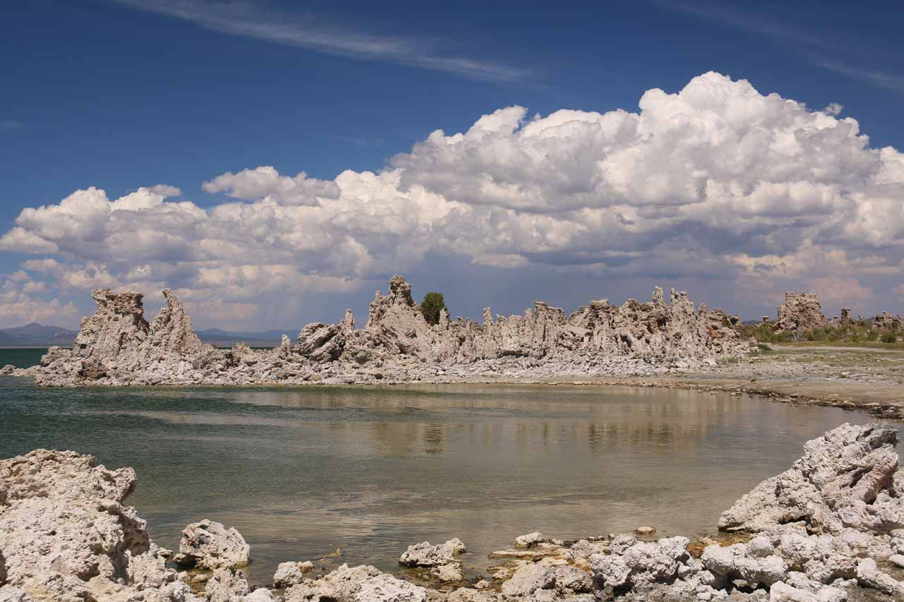 Looking over some neighboring tufas towards the puffy thunderclouds further to the east of Mono Lake