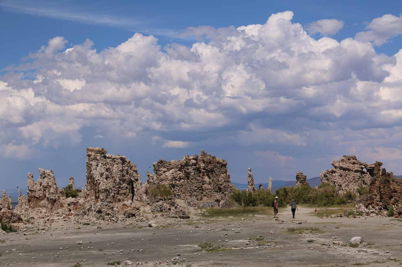 Another look to the east at tufas with menacing thunderclouds and cloud bursts in the background