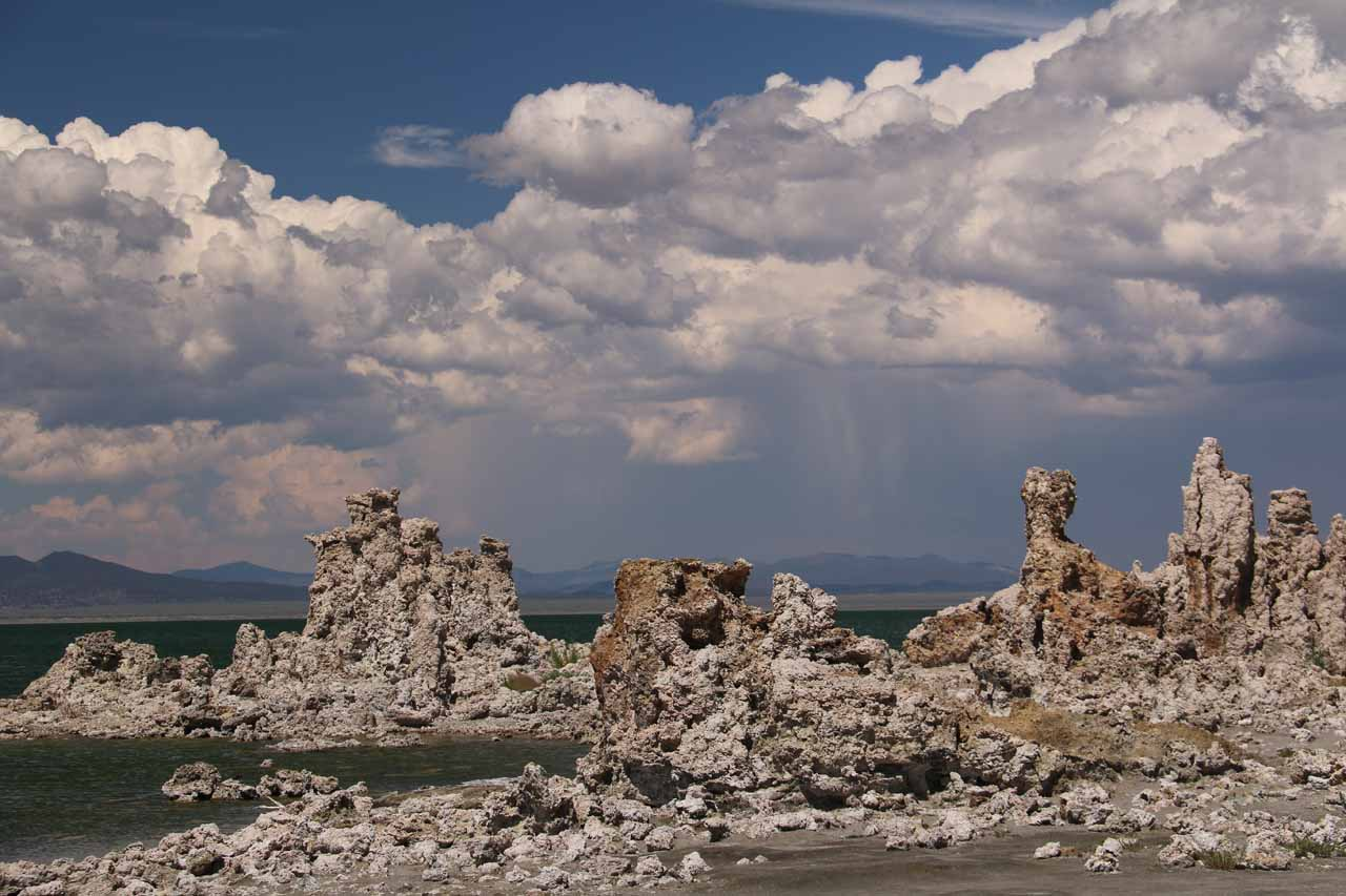 Closer look past the tufas towards the thunderstorm complete with cloud bursts east of Mono Lake