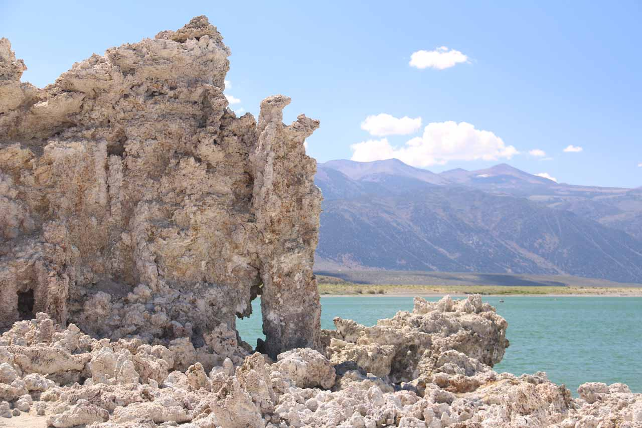 Looking past a tiny arch in the tufa formations towards the weatern shores of Mono Lake