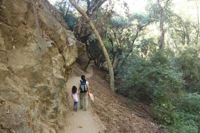 Monrovia_Canyon_Falls_014_11132016 - Julie and Tahia on a part of the Monrovia Canyon Falls Trail that hugged this interesting rock cliff