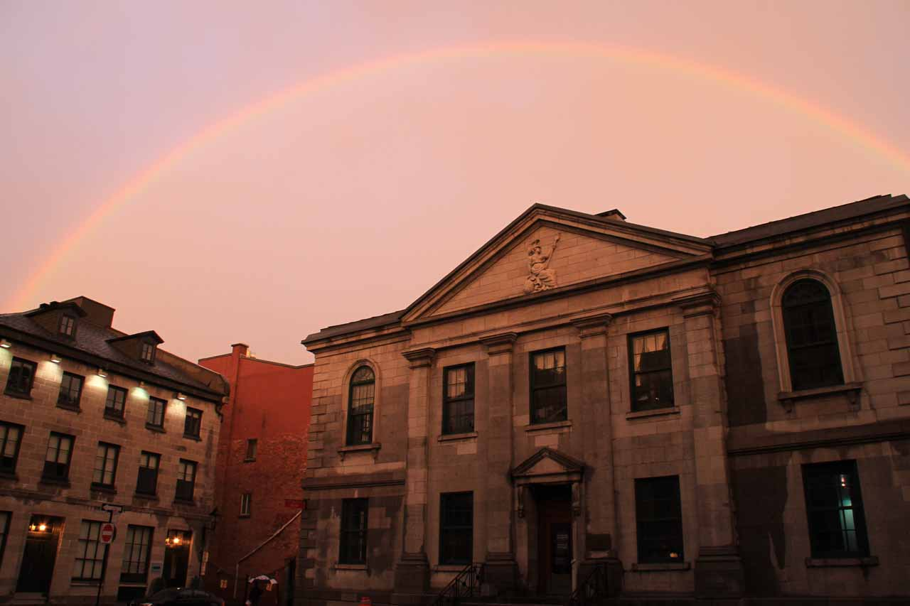 Rainbow arcing over some classic-looking building in Old Montreal