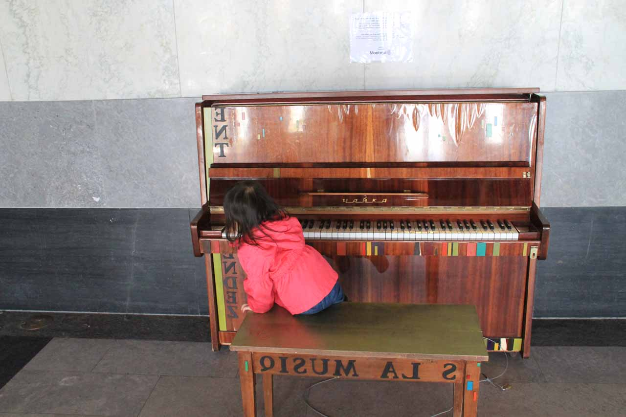 Tahia playing the piano inside the Chalet du Mont Royal