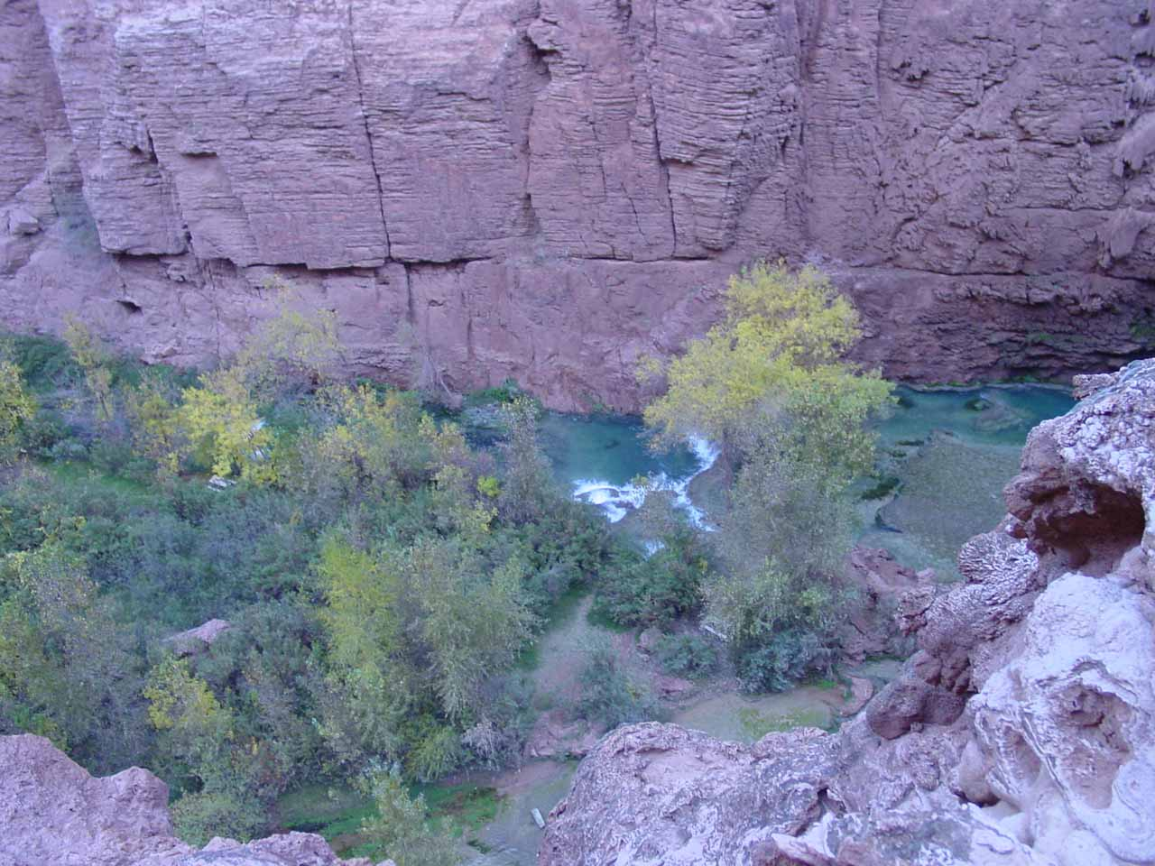 Looking way down at Havasu Creek below Mooney Falls