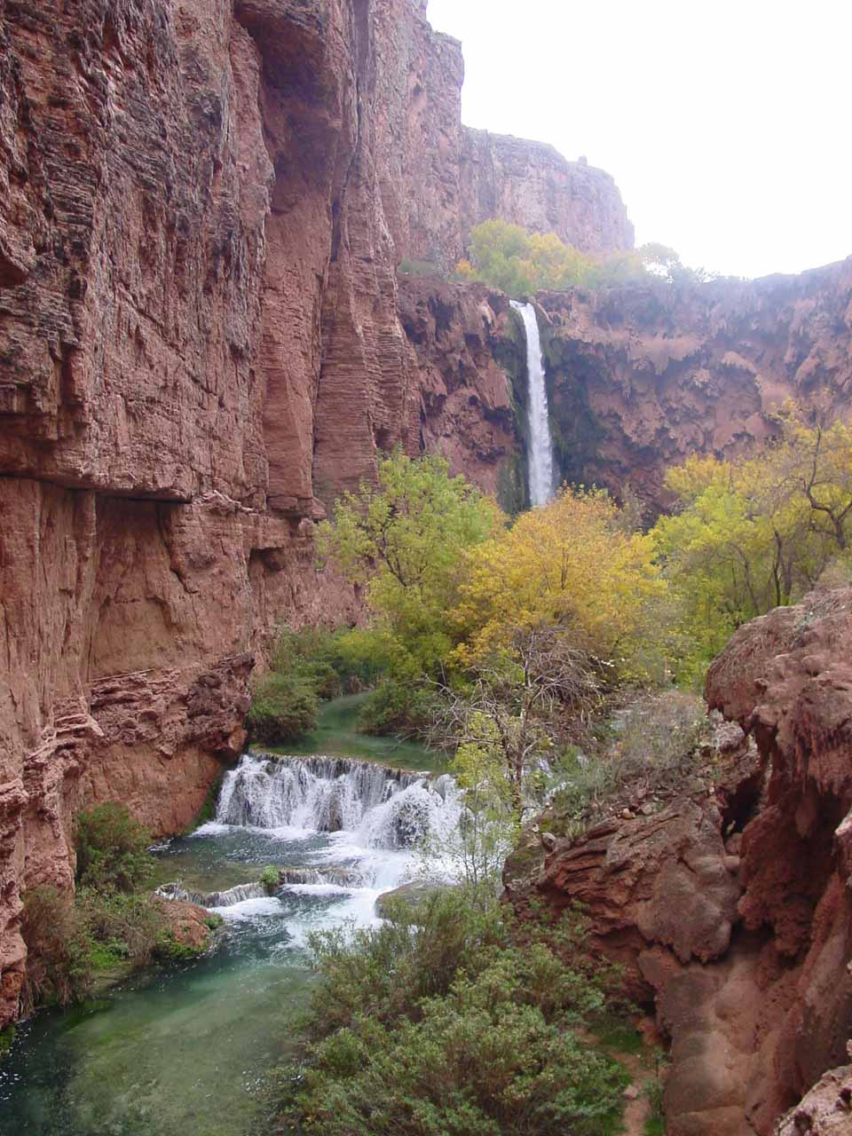 Attractive view of small travertine cascades fronting Mooney Falls in November 2002