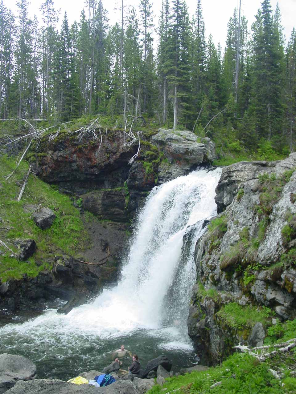 Moose Falls with some people swimming at its base