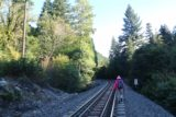 Mossbrae_Falls_007_06192016 - Mom hiking on the concrete railroad ties along one of the more narrower parts of the railroad tracks