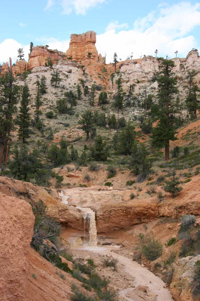 A closer look at the waterfall backed by hoodoos