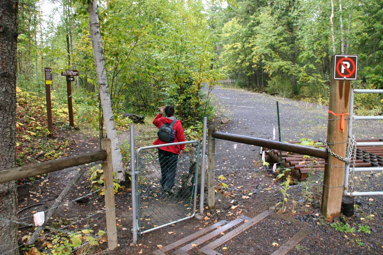 Julie closing the gate behind her at the trailhead