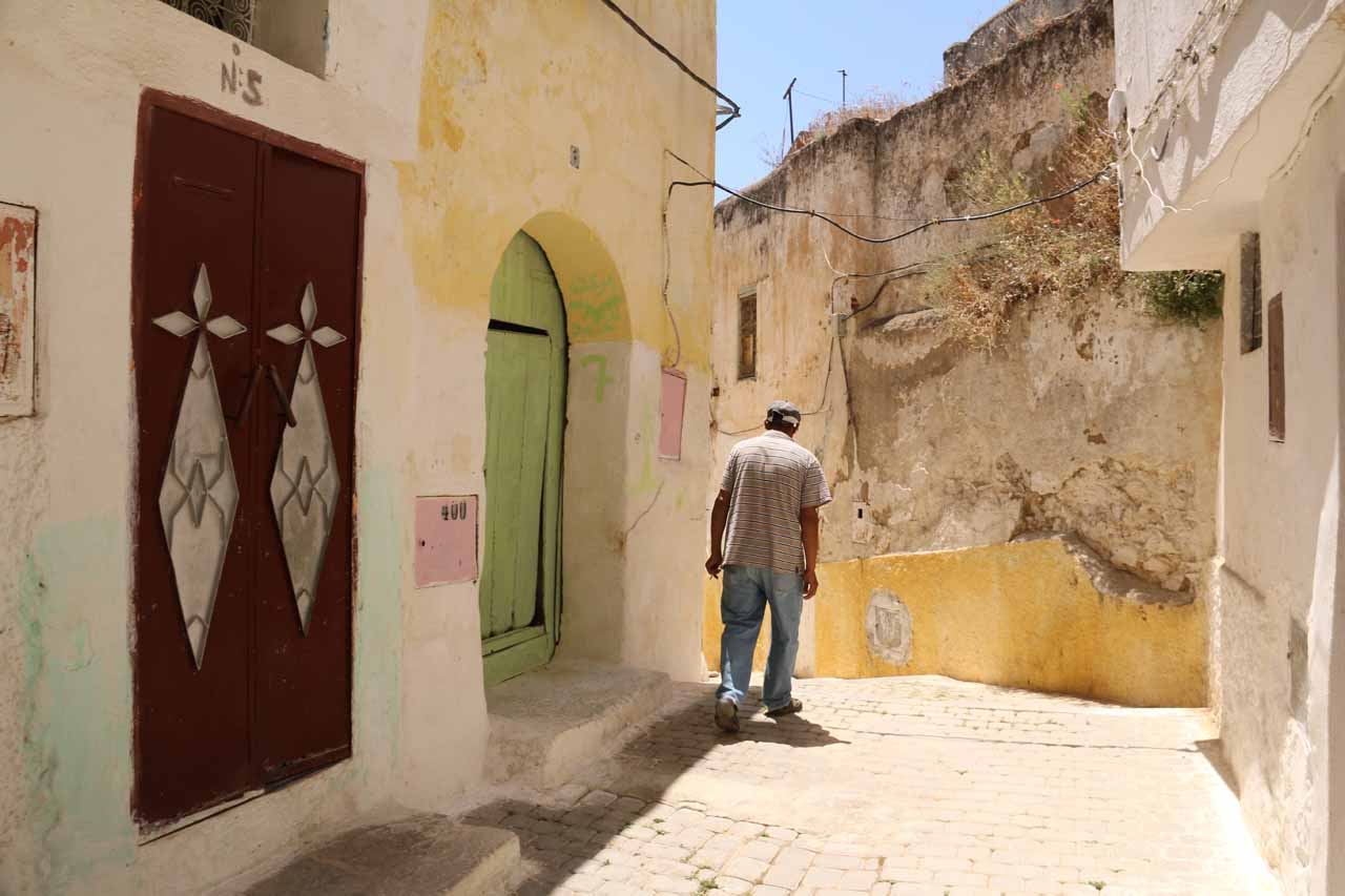 Being guided by a local through some quiet streets of Moulay Idriss
