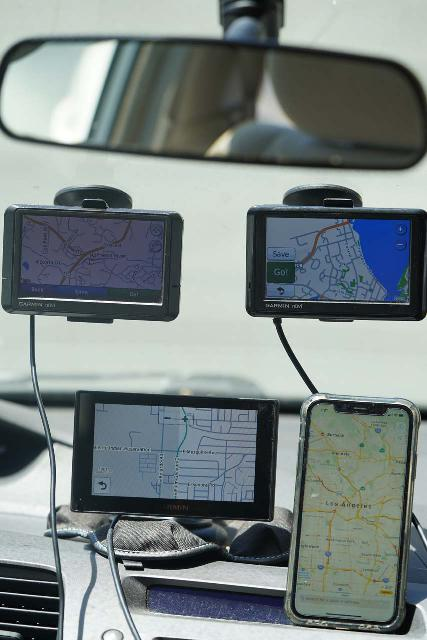 GPS receivers weren't limited to just hiking as this picture shows the devices that I've used for navigating in a car