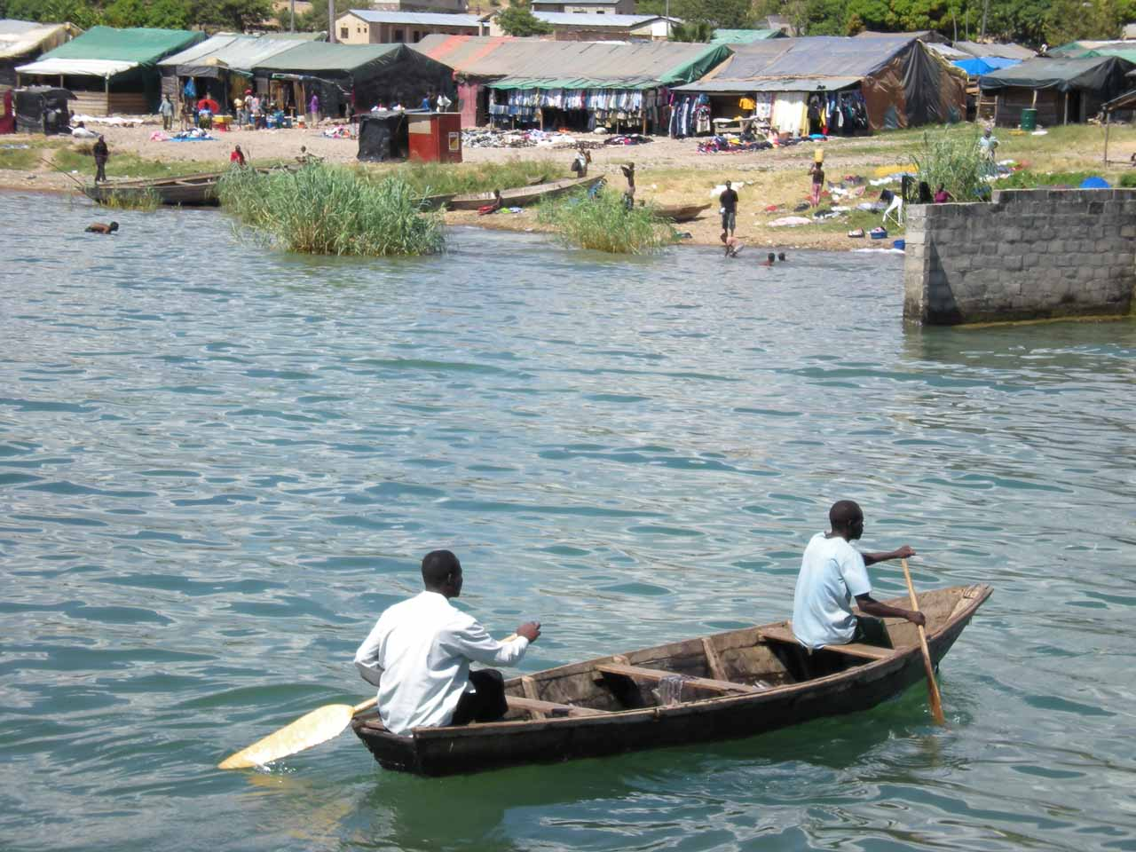 A pair of locals rowing boats full of fish near Mpulungu