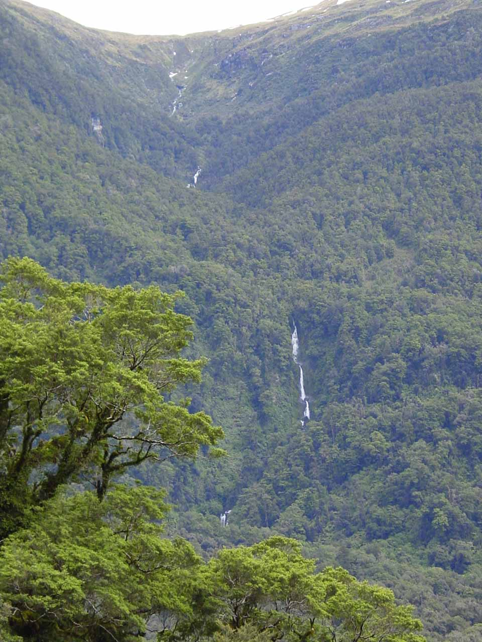 Another tall thin waterfall seen across the Haast River Valley