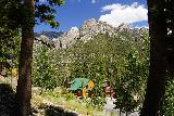 Mt_Charleston_391_08112020 - Looking across Kyle Canyon Road towards the Cockscomb Ridge fronted by some private buildings or homes as I followed the trail to Little Falls from the Cathedral Rock Trailhead in August 2020