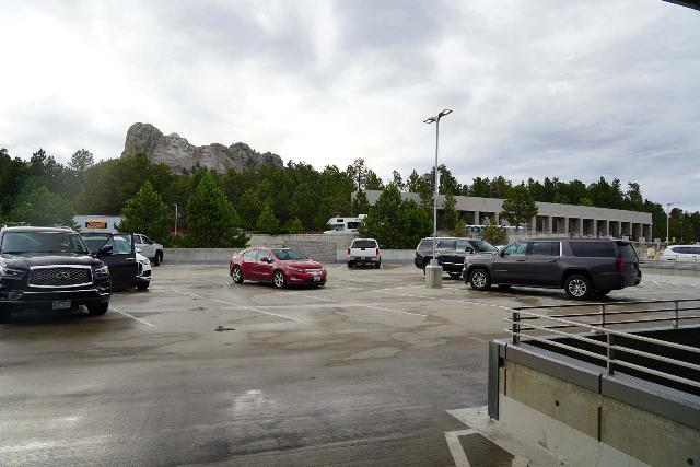 Mt_Rushmore_002_07292020 - The context of the paid parking structure with Mt Rushmore in the background