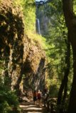Multnomah_Falls_17_092_08162017 - Context of vertical cliffs and the trail with the upper drop of Multnomah Falls as seen on the descent