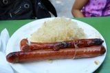 Munich_638_06302018 - This was the huge beef wurst with sauerkraut that we picked up at one of the food kiosks in the beer garden by the Chinese Tower in the English Garden
