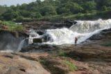 Murchison_Falls_225_06142008 - Julie standing next to the rushing Murchison Falls.  Make sure you don't get too close to the rushing water!