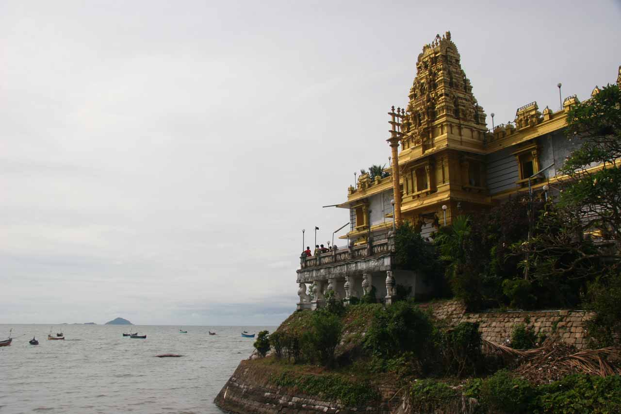 Looking past some golden temple overlooking the ocean at Murudeshwar