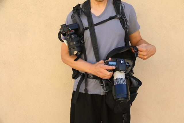 This is me carrying two cameras, where the one by my right bicep was the Sony Alpha 7 III with the Sony SEL24105G lens and the one by the camera bag was the Canon EOS 60D with Canon EF 70-200mm L lens