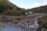 Naena_Falls_025_10182016 - Looking back downstream past the first suspension bridge towards the context of the shops and the car park on the other side of the Sekigawa River