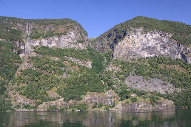 Naeroyfjoren_Cruise_063_07232019 - Contextual view towards some thin cascades (including one on the Høydøla or Flugandefossen, I think) while on Aurlandsfjorden