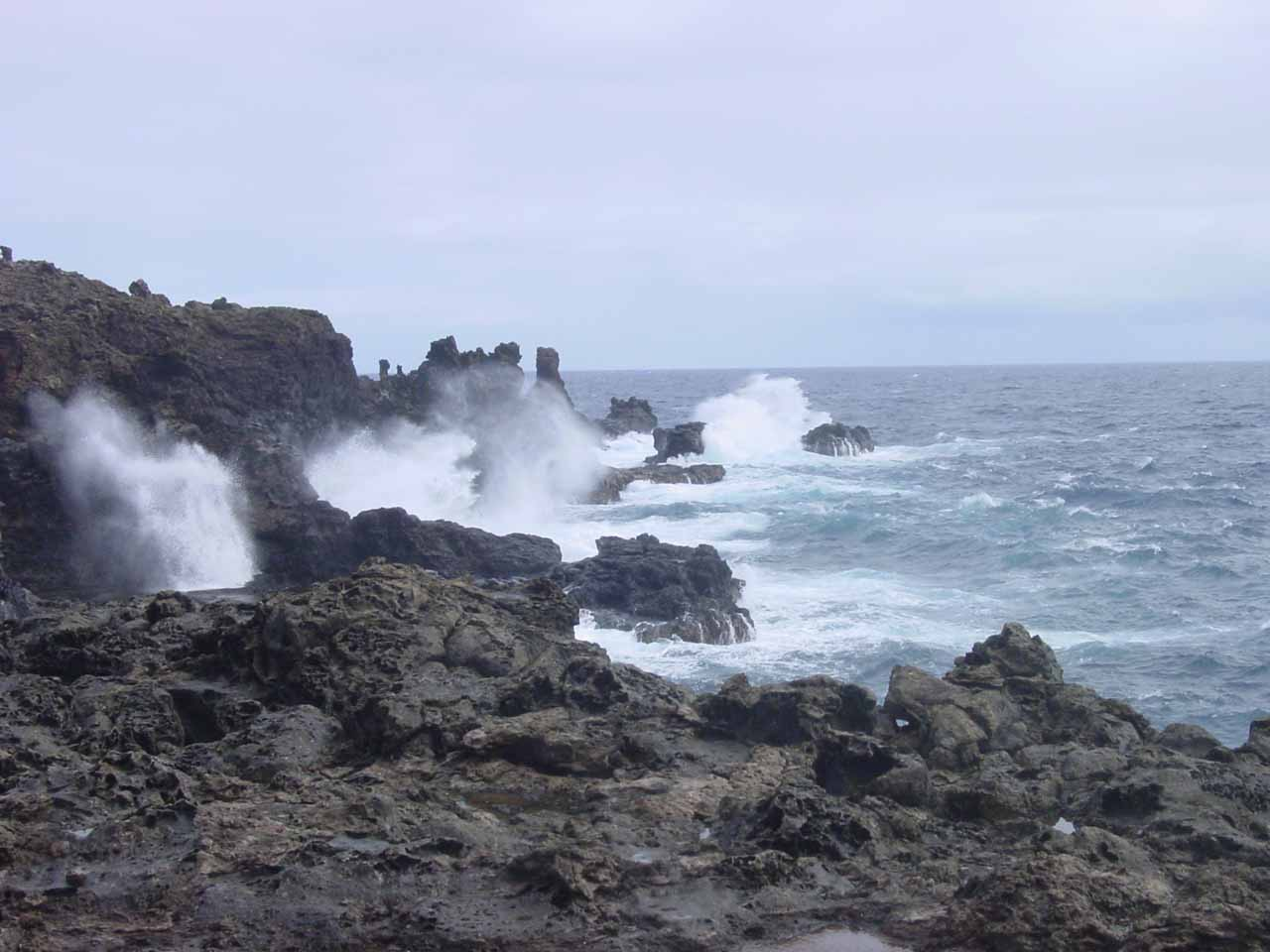 More blowholes set against the turbulent ocean