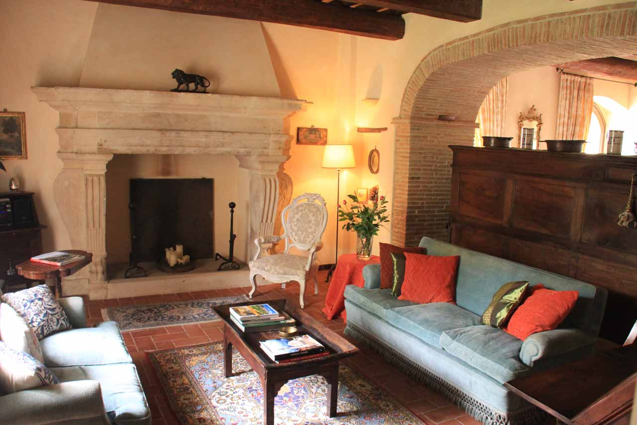Inside Torre Palombara with its warm and inviting living room