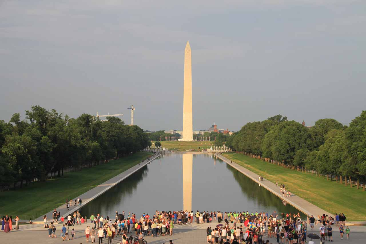 Looking back towards a glowing Washington Monument reflected in the Reflecting Pool from the steps of the Lincoln Memorial