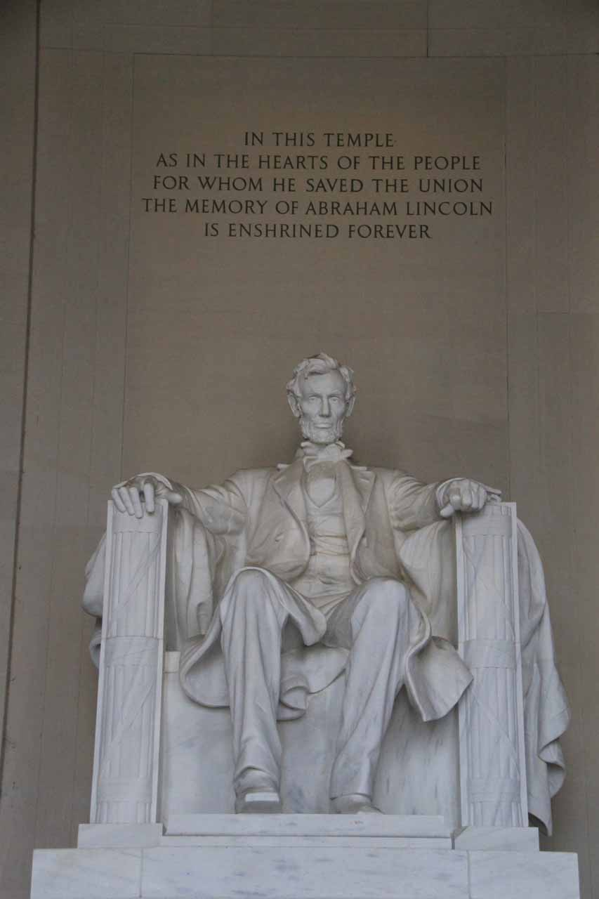 The familiar view of the Lincoln Statue with some inscription above him