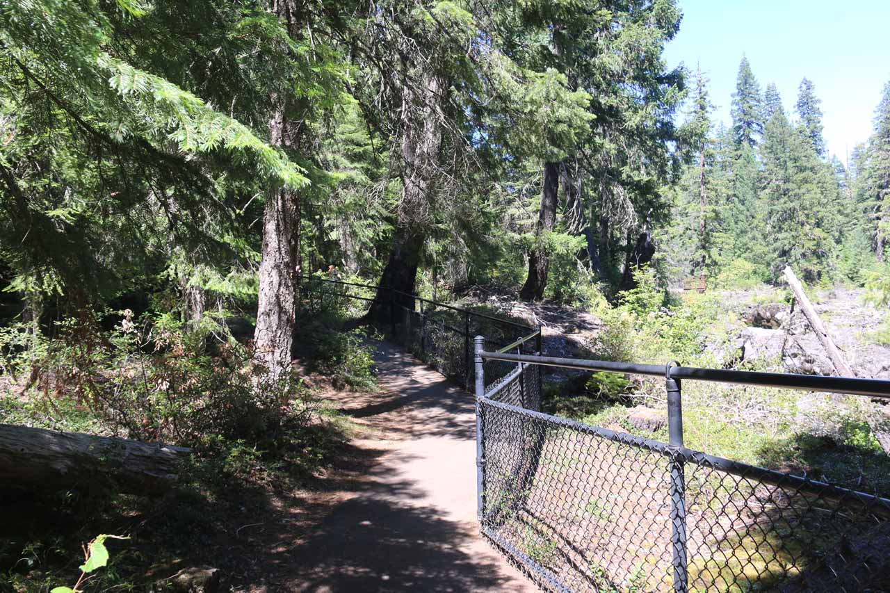 The paved footpath continued to meander upstream past where the Rogue River had disappeared towards its inlet