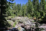 Natural_Bridge_rogue_032_07152016 - Looking upstream towards where the majority of the Rogue River eerily disappeared beneath the Natural Bridge revealing only hints of the turbulence below such as blowholes, potholes, and other rushing sections where the lava tube had collapsed