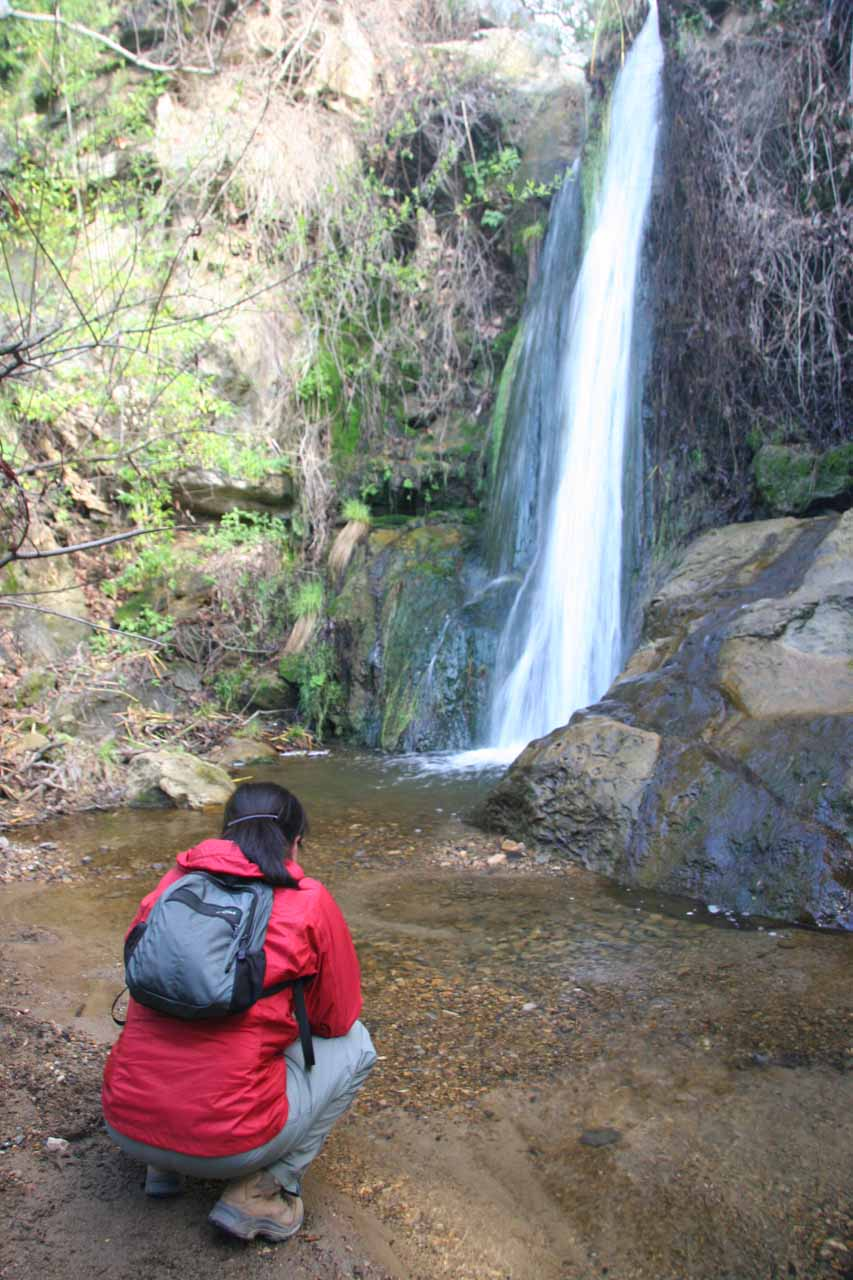 Julie squats in front of Newton Canyon Falls for some context