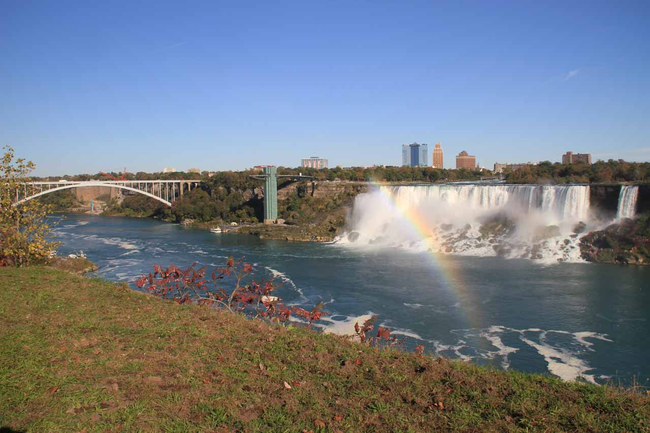 Context of American Falls and rainbow with the Rainbow Bridge in the distance