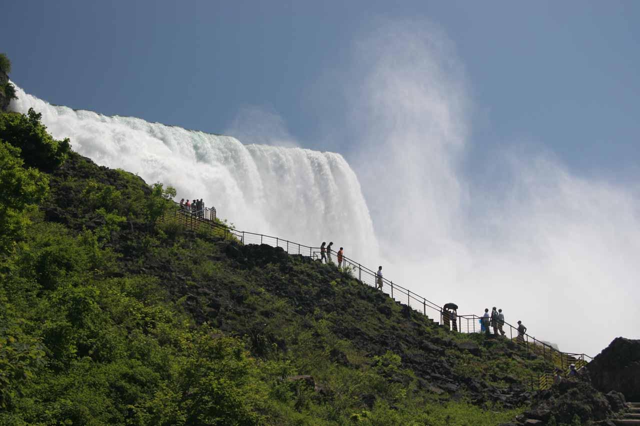 Walkers dwarfed by American Falls