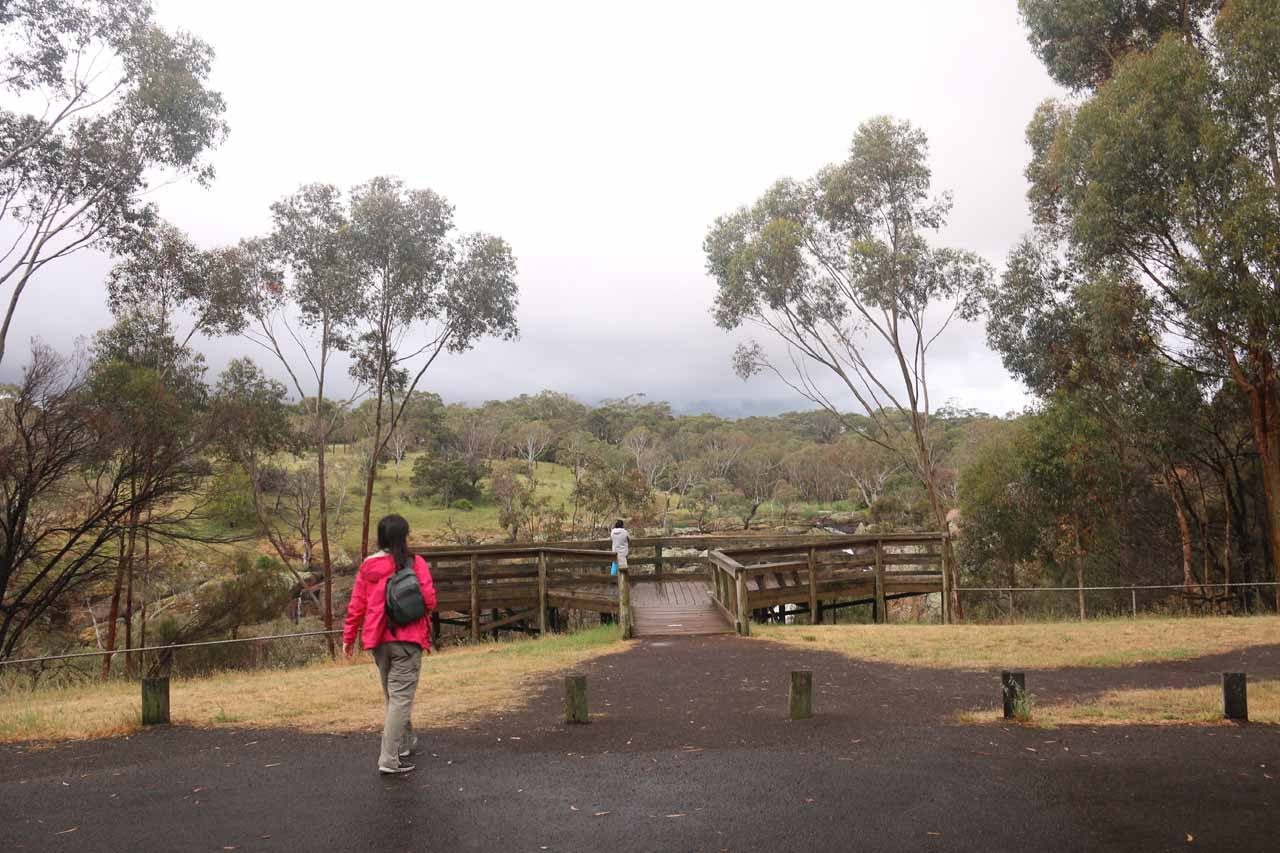 Julie approaching the viewing deck right next to the car park for Nigretta Falls