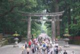 Nikko_070_05232009 - Large crowd walking beneath a large Torii at the Toshugu Shrine