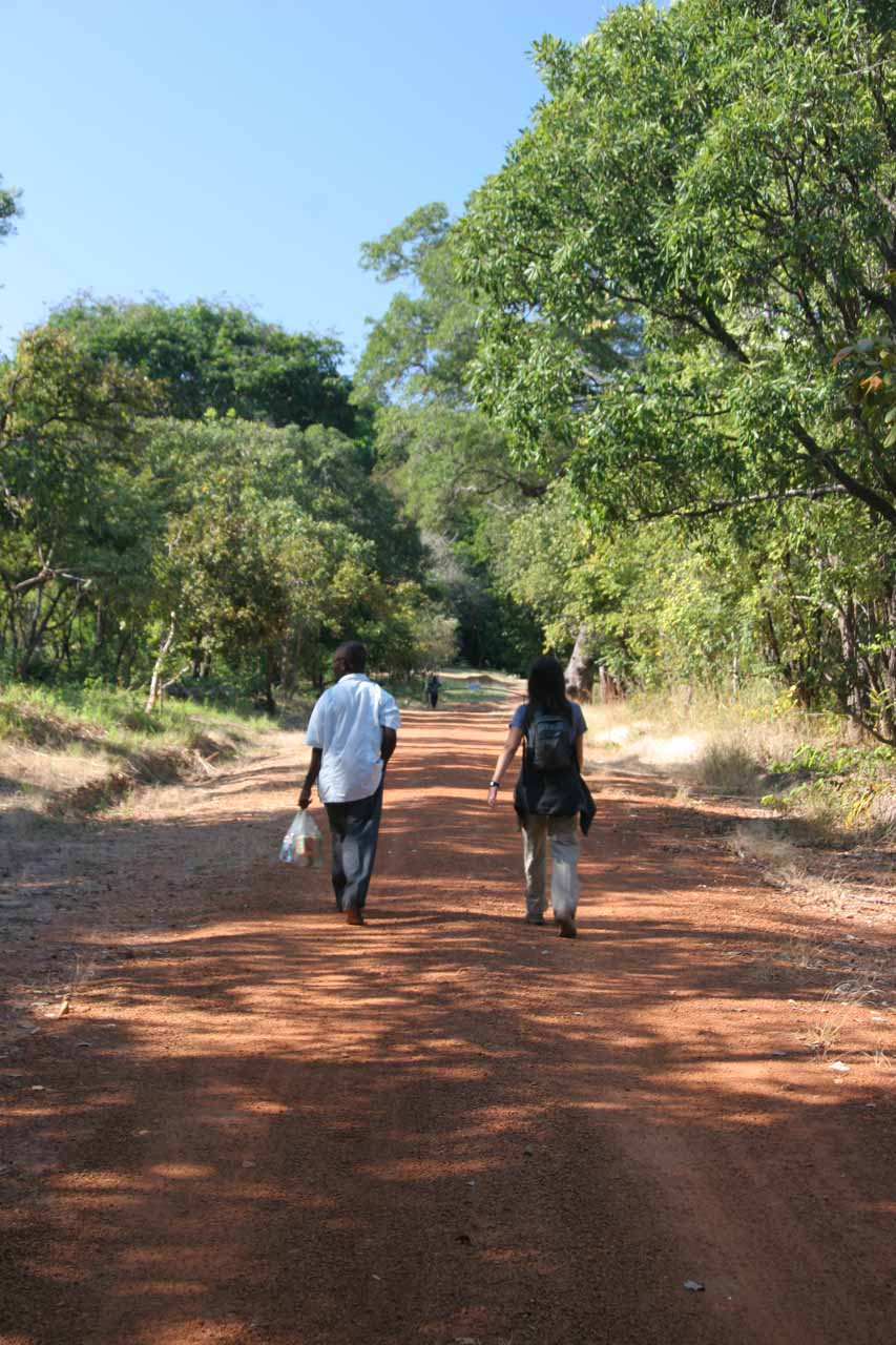 Julie and Joseph still on the 2km unpaved spur road to Ntumbachushi Falls