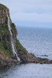 Ocean_Waterfall_telephoto_029_08142021 - Portrait look at Migandifoss with a boat floating in front of it for scale