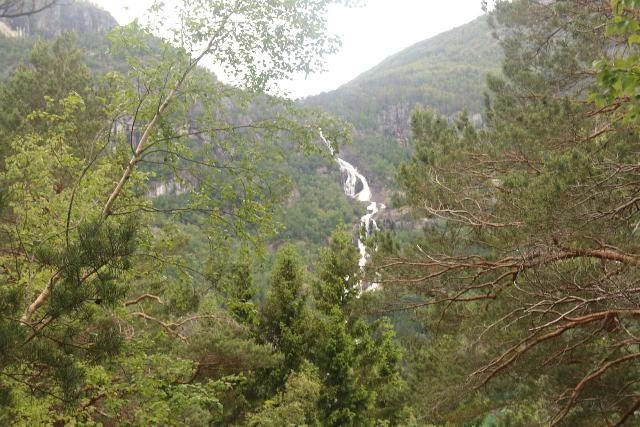 Oddadalen_101_06232019 - Once above the initial climb, I was able to get this partial view of Strondsfossen.  The view would have been really nice if the trees weren't in the way because the lake Sandvinvatnet wouldn't look so flat from up here