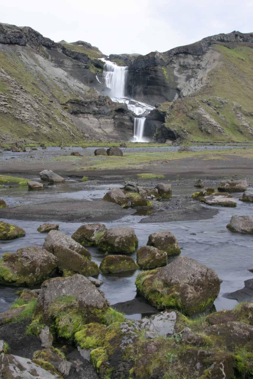 Looking over mossy rocks across the river towards Ófærufoss