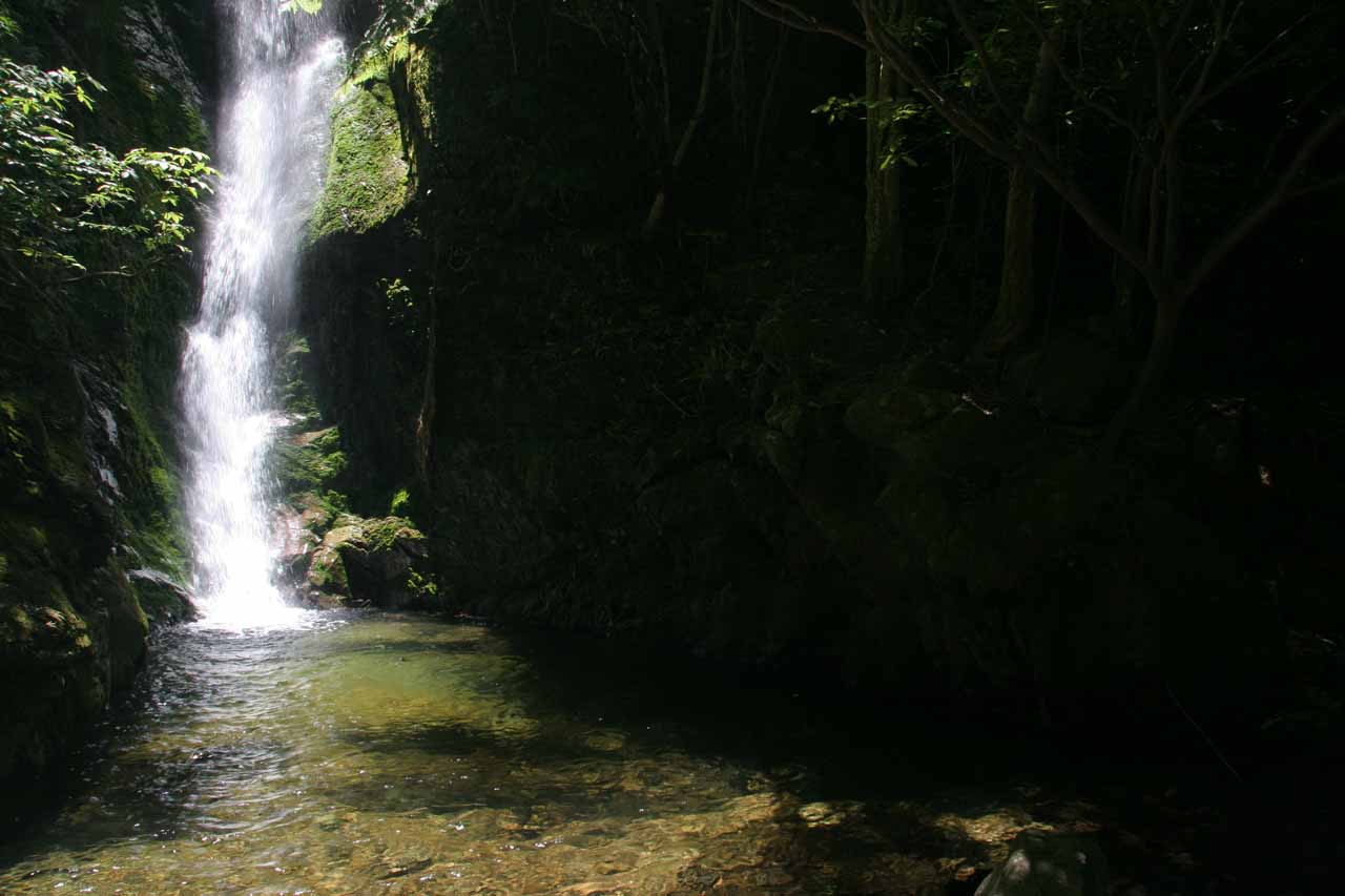 Ohau Falls and its narrow plunge pool in partial shade