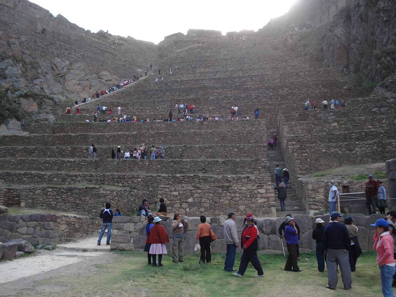 Going up the steps of the ruins by Ollantaytambo