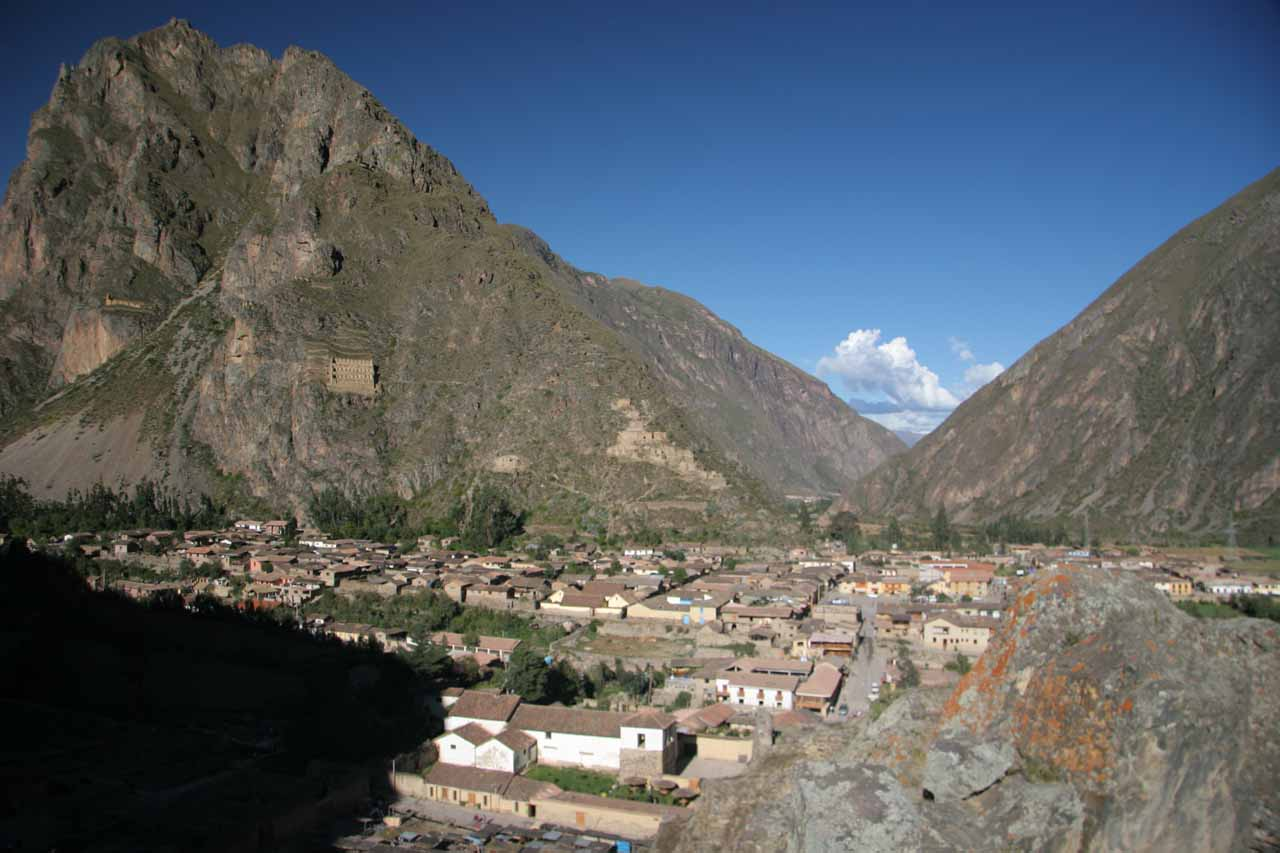 Looking down at the town of Ollantaytambo while perched high up on the ruins.  Notice the structures perched high up on the opposing cliffs