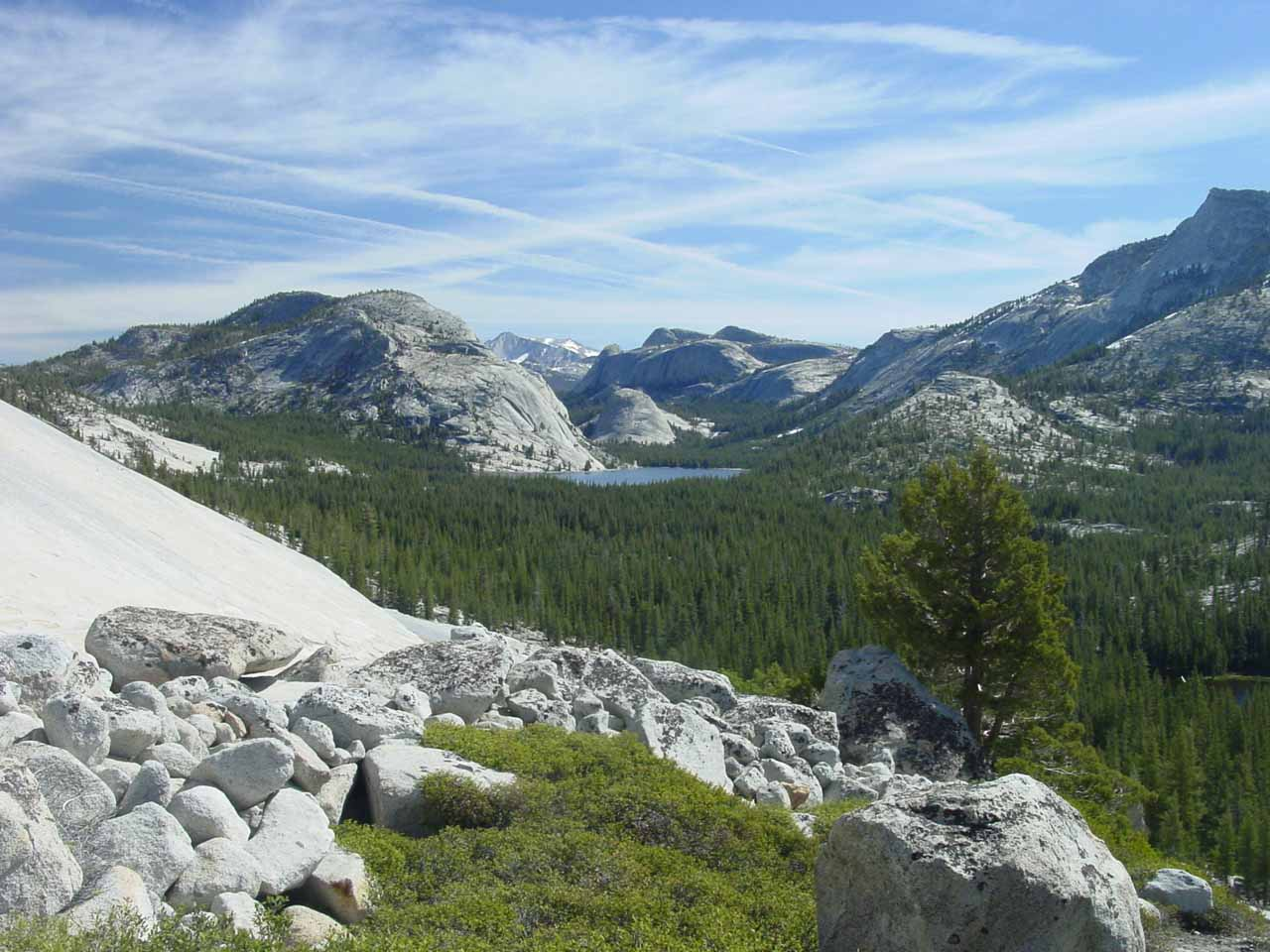 Distant view of Tenaya Lake and surrounding granite formations from Olmstead Point