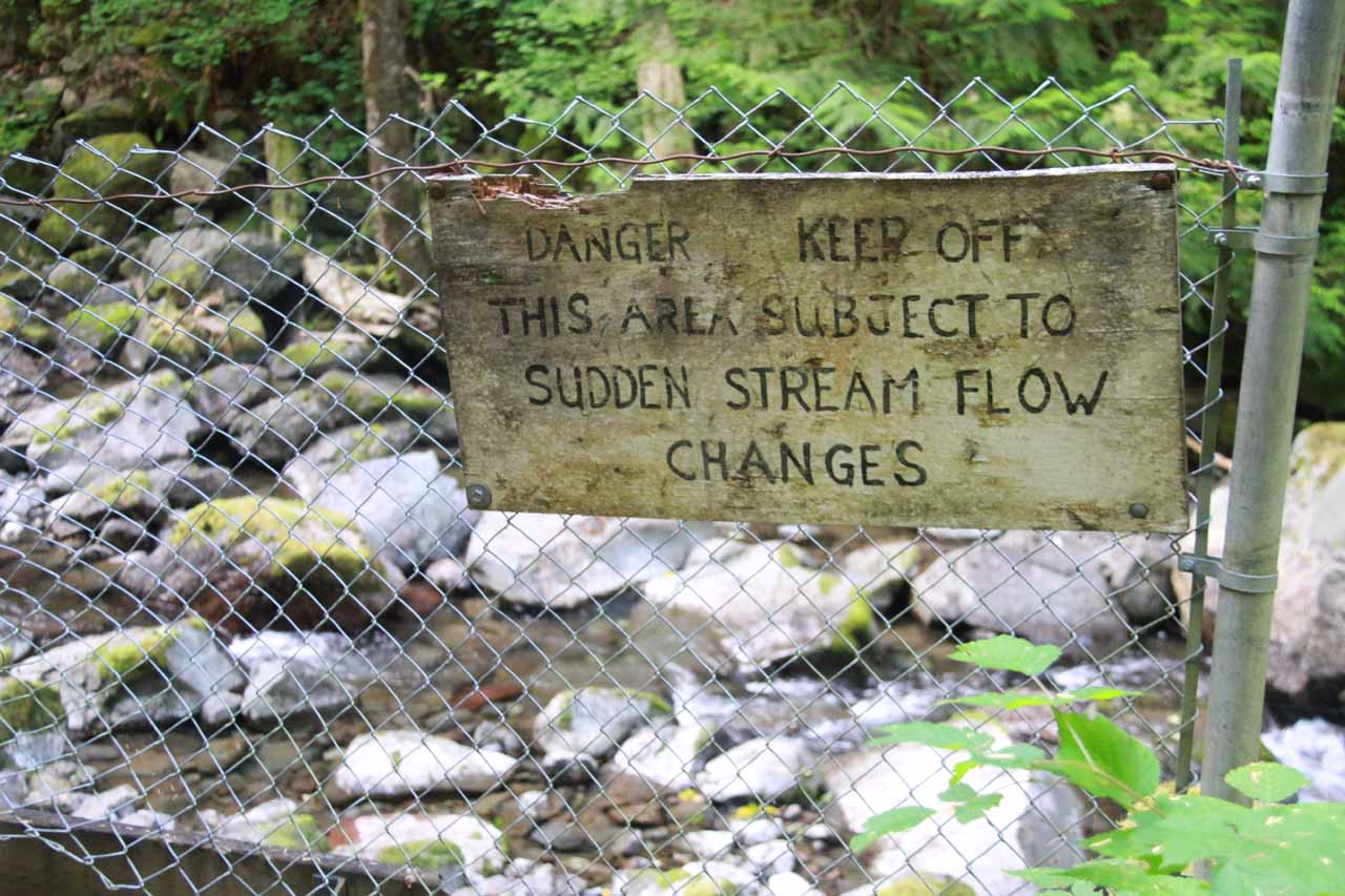 Sign warning against straying onto the creek