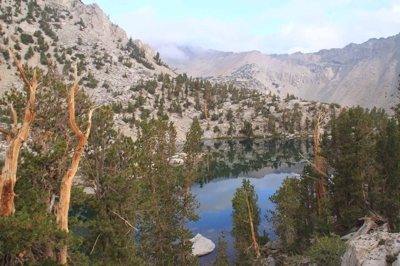 Looking over Bench Lake towards the partially cloudy Kearsarge Pass